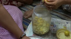 Some women are cutting Lemon to make spicy Lemon pickle Stock Footage