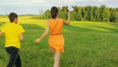 Young kids playing with a paper airplane in the field, dreaming, childhood Stock Footage