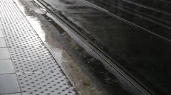 Tramway arrival ina rainy day Stock Footage