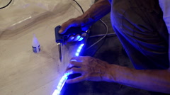 Installation of the blue LED strip light. Stock Footage