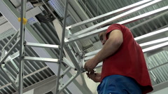Assembling with a wrench of a Metal construction. Tightening the bolt and nut. Stock Footage