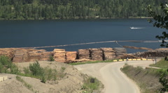 British Columbia Adams Lake logs and boat  Stock Footage