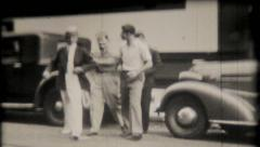 1147 - young men joke around on the street - vintage film home movie Stock Footage