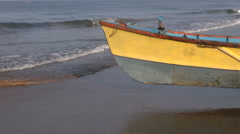 colorful wooden boat on Arabian sea coast, Karnataka, India - stock footage