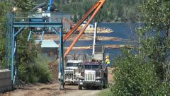 Stock Video Footage of British Columbia Adams Lake two lot trucks