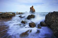 beautiful sea scape of waves splashing on rock  use for multipurpose natural - stock photo