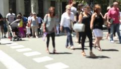 Time Lapse Crowd of anonymous people crossing busy city street Stock Footage