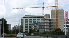 Building site with cranes in full progress in England, UK Europe Stock Footage