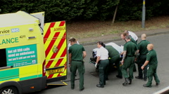 Rescue operation.Paramedics pushing the patient on the trolley toward ambulance. Stock Footage