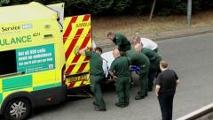 Rescue operation.Paramedics pushing the trolley with the patient into ambulance. Stock Footage