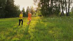 Two friends running in the field, a paper plane, childhood, dream Stock Footage