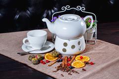 Teapot and cup of green tea Stock Photos