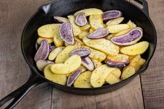 Blue and white potatoes frying Stock Photos