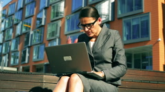 Unhappy businesswoman working on laptop and receiving bad news Stock Footage