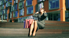 Happy businesswoman relaxing and looking on her shopping Stock Footage