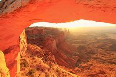 Glowing mesa arch at sunrise, canyonlands national park, utah, usa Stock Photos
