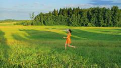 Young girl runs in the field and throws a paper airplane, dream, freedom Stock Footage