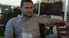 Man drinking beer in the restaurant on the terrace Stock Footage