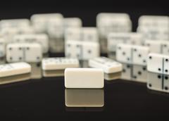 white dominoes with single blank domino - stock photo
