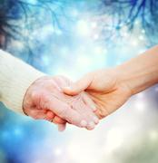 Holding hands with elderly woman Stock Photos