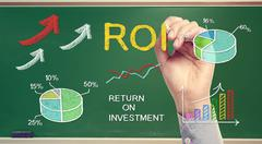 hand drawing roi (return on investment) - stock illustration