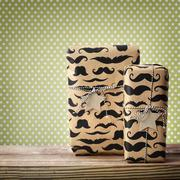 Mustache pattered gift boxes with star shaped tags Stock Photos