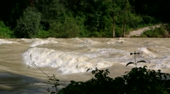 Flooded river with a breaking wave Stock Footage