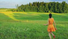 Beautiful girl running in the field, feeling freedom, dreaming Stock Footage