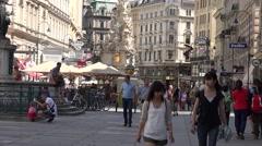 ULTRA HD 4K Tourist people visit  Graben street Plague Column shop Vienna city  Stock Footage