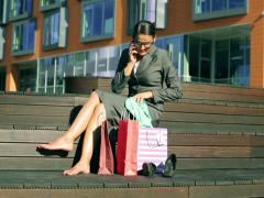 Excited businesswoman chatting on cellphone about her shopping Stock Footage