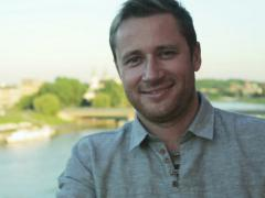 Man smiling to the camera in the terrace next to the river Stock Footage