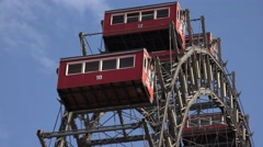 ULTRA HD 4K Closeup Viennese giant wheel red cabin moving rotation day Vienna  Stock Footage