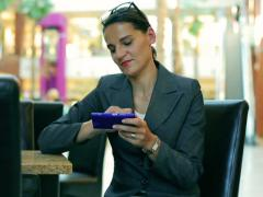 Businesswoman sitting in the restaurant and typing on smartphone Stock Footage
