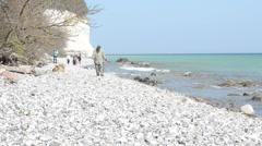 Timelapse - people walking Ruegen Island along the chalk cliff rocks Stock Footage