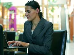 Happy businesswoman working on laptop in the resturant in modern place Stock Footage