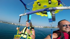 Tourists flying on a parachute, parasailing, Alanya Turkey 11 Stock Footage
