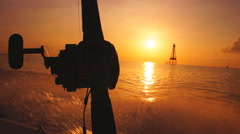 Saltwater fishing in Florida Keys, Boat heading offshore at sunrise  - stock footage