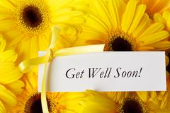 get well soon card with yellow gerberas - stock photo