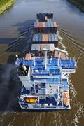 beldorf (germany) - container vessel at kiel canal (retouched) - stock photo
