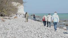 People on Ruegen Island along the chalk cliff rocks Stock Footage