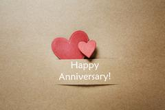 happy anniversary message with small hearts - stock photo