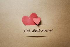 get well soon message with red hearts - stock photo