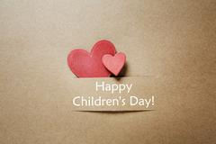 Childrens day message with red hearts Stock Photos