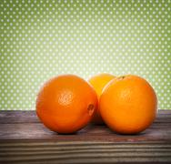 oranges on wooden table - stock photo