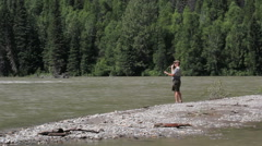 Canada British Columbia North Thompson River fly fisherman whips line 3 Stock Footage