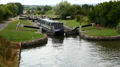 Caen Canal Locks. High shot of a boat in a lock - stock footage