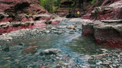 Hikers Cross a Stream in Red Rock Canyon - Timelapse Stock Footage