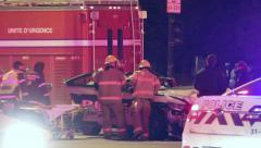 Fire fighter pulling police door after crash with patient trapped Stock Footage