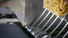 Packaging raw fusilli in a pasta factory. Stock Footage