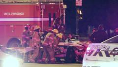 Extrication with jaws of life on police car wreck Stock Footage